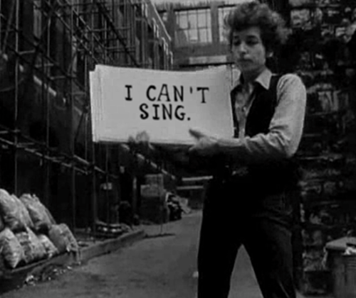 Bob Dylan holding signs meme