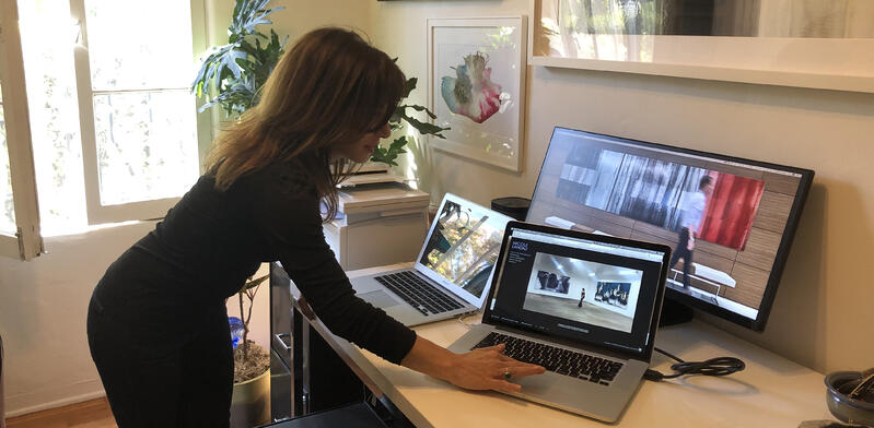 At her desk, Nicole showed the group how she custom collages and modifies each piece to fit the scale and personality for every individual client.