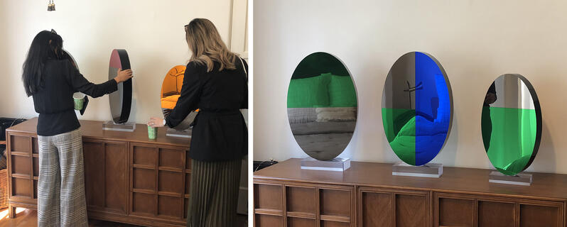 A side by side view of 3 of Shana's sculptures, which swivel on an acrylic base and reflect light in the space.