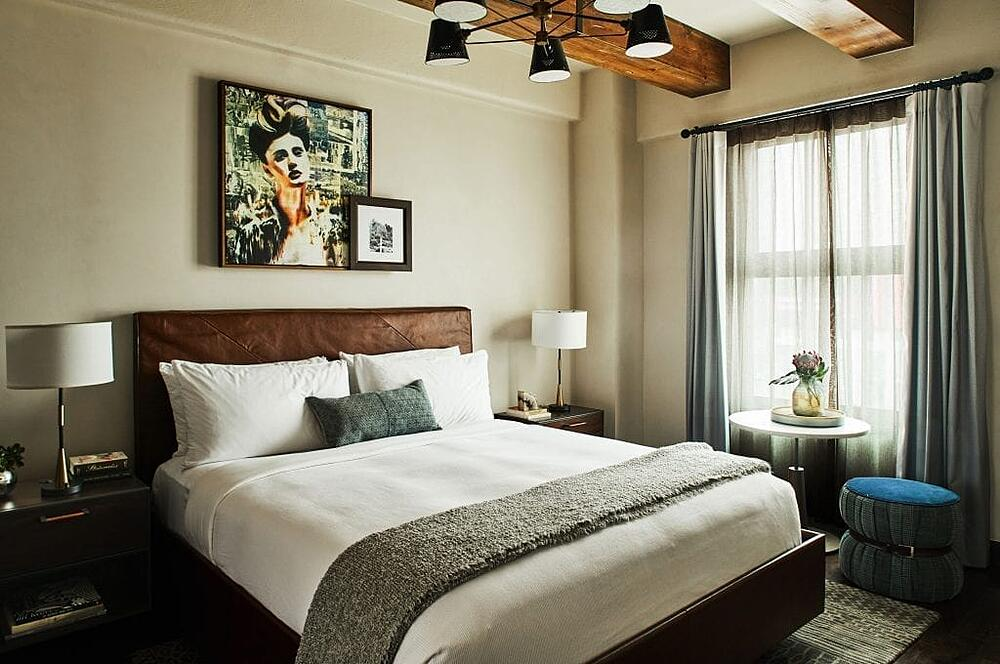 "The Figueroa Hotel in DTLA features a portrait by Annie printed on gallery wrapped canvas at 33""W x 35""H, flanked by ""San Gabriel"" by LA local artist Mary Rasmussen"
